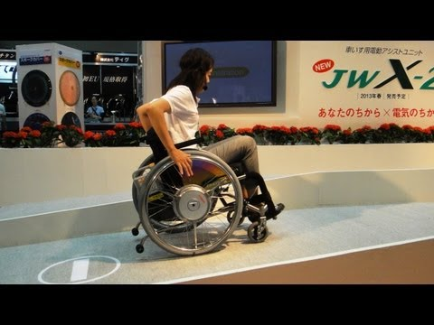 Manual wheelchair propulsion assist devices